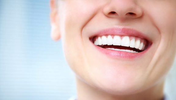 Happy National Smile Power Day! The Benefits of Smiling More with Heroes Dental