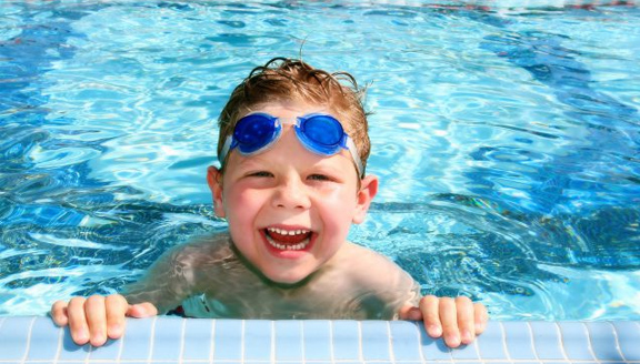 Your Teeth, Pool Time, & Tips to Keep Those Pearly Whites Shining